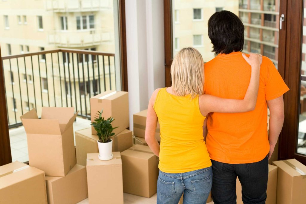 Couple in apartment with boxes describing Apartment Moving