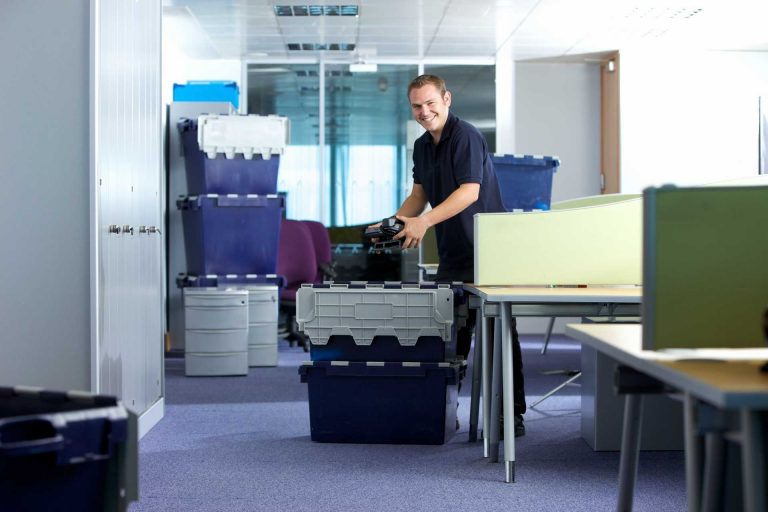 Man standing in the middle of the office preparing it forn Moving