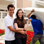 Couple in front of Residence describing Residential Moving