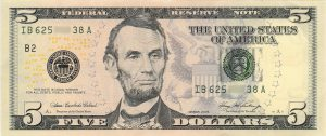 A 5 dollar bill.