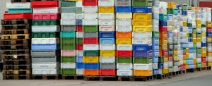 numerous, stacked, colorful containers
