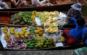 2 boats filled with exotic fruit