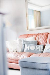 White room with a pink couch.