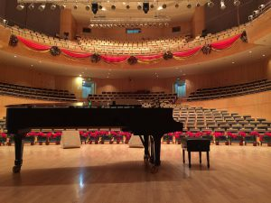 After moving your piano to Brooklyn you could also play on a black grand piano in a concert hall