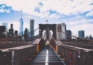 a man walking on Brooklyn bridge
