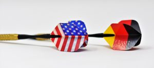 two darts with an American and German flag