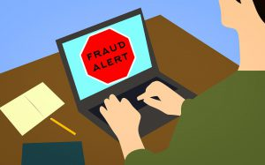 lap top that says fraud alert - avoid Manhattan moving scams