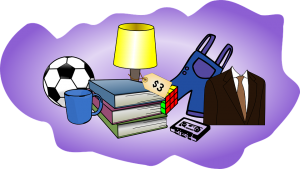 items for a garage sale such as books, a football, a lamp, Rubik's cube, a blue mug, blue overalls, a suit and a cassette before you hire affordable movers in Staten Island
