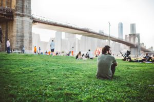 Man sitting and looking at New York, enjoying outdoor activities in the Big Apple