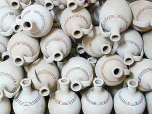 A lot of white jugs put without a specific order.