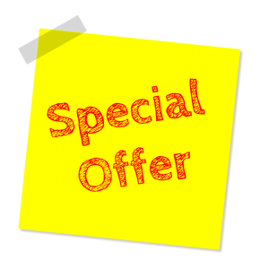 A yellow post-it note with the words `special offer` written on it in red.