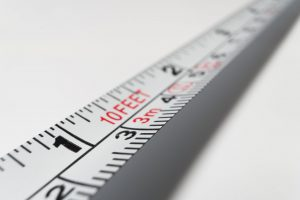 A measuring tape on a white surface.