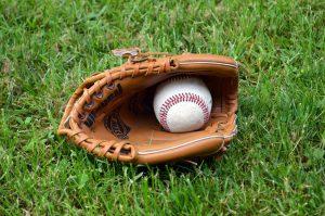 Basball glove with a baseball ball.