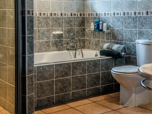 A bathtub and a toilet bowl, which should be included when baby proofing your home.