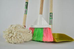 A broom, a mop and a dustpan
