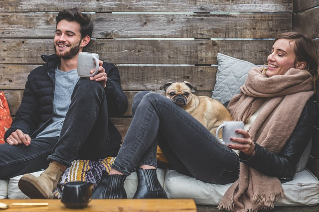 Man and woman laughing after resolving most common roommate issues.