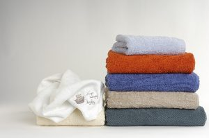 Folded towels in different colors.