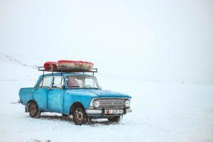A blue car on the snow