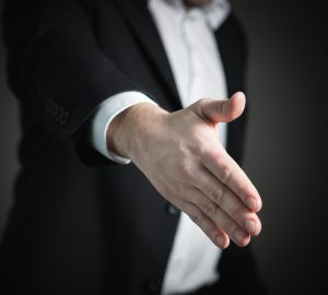 man coming to shake someone's hand