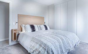 Minimalistic white bedroom.