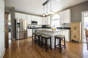 An elegant and clean kitchen with hardwood floors.