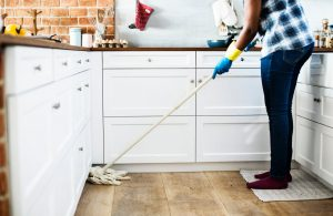 household cleaning tips - woman cleaning the floor