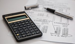 stored property tenant insurance - a calculator, pen and paper