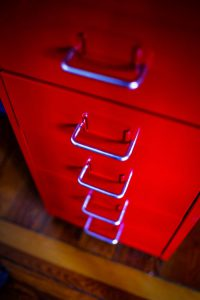 stored property tenant insurance - red folder cupboard
