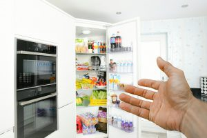 Hand pointing on the fridge