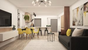 Kitchen, yellow chairs, grey door to living room