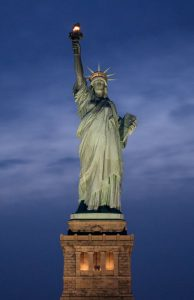 must-see NYC spots is statue of liberty on Liberty island