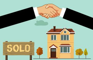 "Illustrated shaking hands over a house and a sign that says ""sold"""