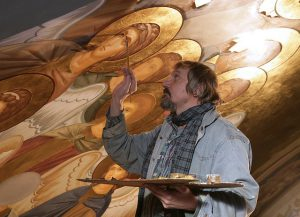 Artist painting a ceiling.