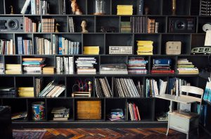 A big bookshelf wall like this is a great way to store your books in NYC home.