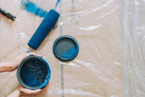 blue bucket of paint and a brush