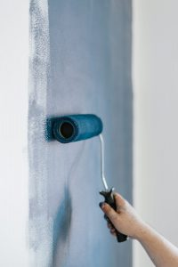 brush painting the wall