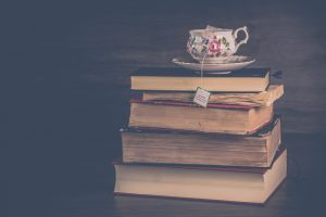 A tea cup on top of books
