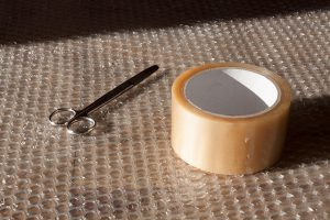 Bubble wrap, tape and scissors - find packing supplies like these when you're moving house