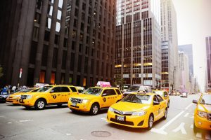 Five yellow cabs in a New York street