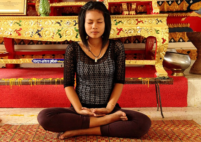 Women meditating - a great way to relax when packing your household
