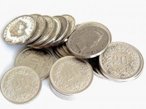 Silver coins on a white surface