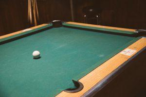 Green pool table.