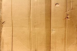Close up of brown cardboard. Most people use cardboard moving boxes NYC.