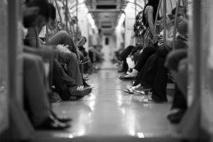 Black and white photo of people on the subway