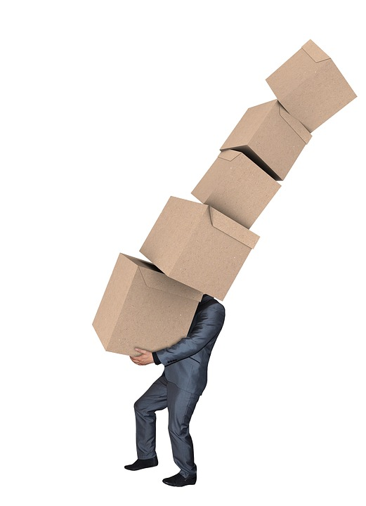 a man with boxes - Things that can go wrong when moving