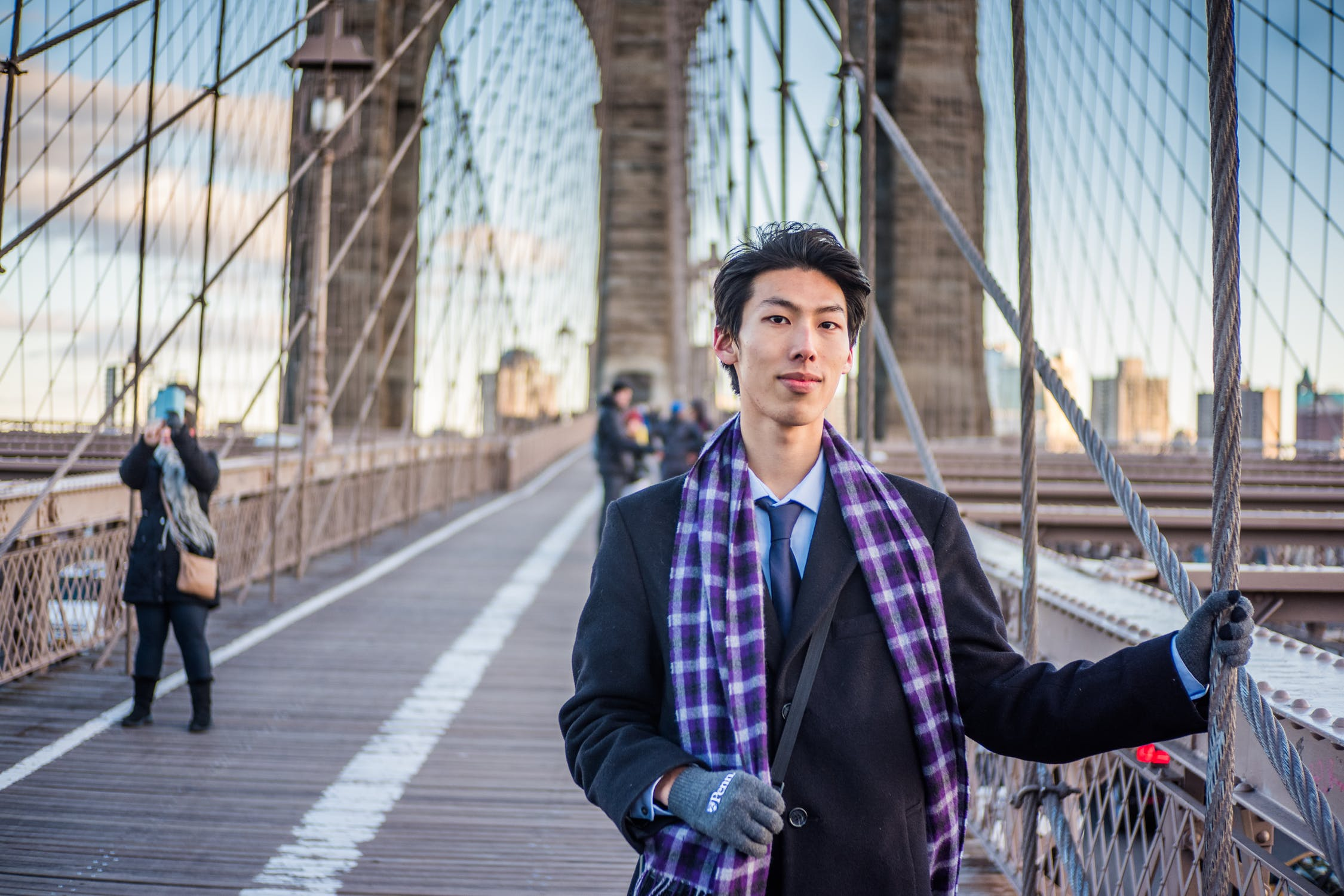 man walking a bridge to find a roommate in NYC
