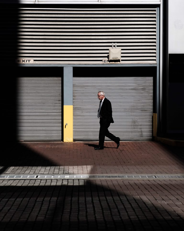 A man walking in front of storage unit door