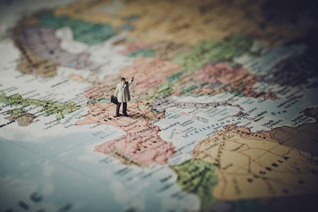Close up of a figurine on a world map