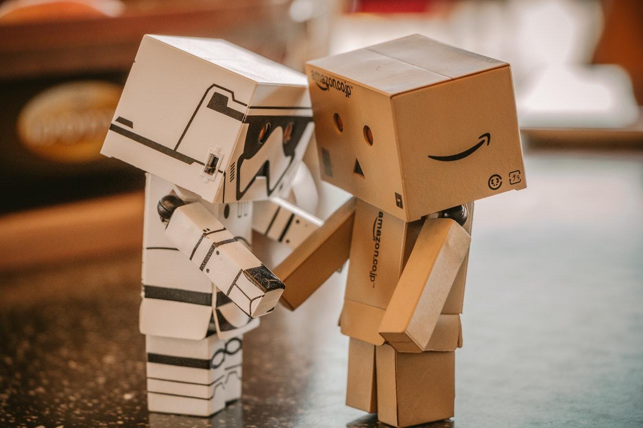white and brown cardboard box figurines