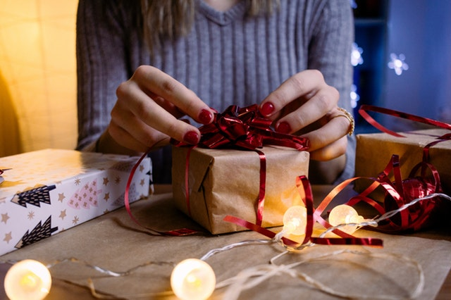 woman wrapping a gift